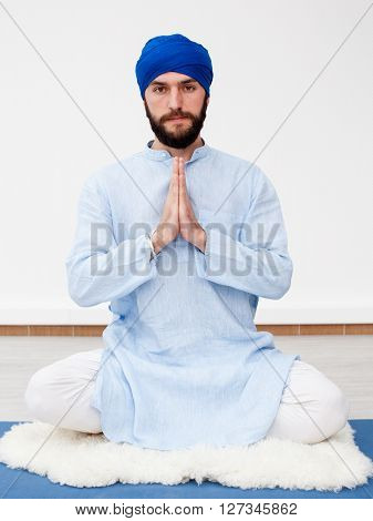 Meditation. Portrait Of A Young Bearded Man In A Turban