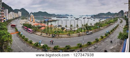 December 14 2013 the island of Cat Ba Vietnam. Waterfront on the Bay. At the coast are many boats at anchor.