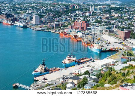 ST. JOHN'S CANADA - AUGUST 26 2015: Several offshore supply ships are docked in St. John's Harbour. The city is the capital of the province of Newfoundland and Labrador.