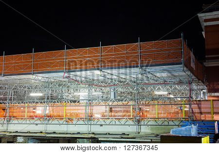 Nightview of scaffolding elements in Lugano railway station