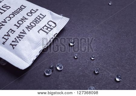Close Up Silica Gel Or Desiccant In Paper Bag On Black Background