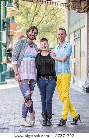 Three gender fluid friends on a city sidewalk poster