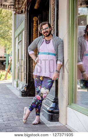 Attractive young gender fluid man in cross drag