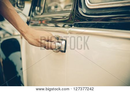 Hand on the car handle. man holding his hand on the casr handle