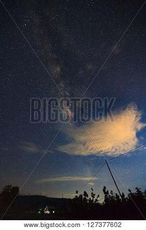 Silhouette Of Tree With Cloud And Milky Way. Long Exposure Photograph..with Grain.