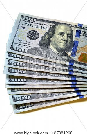 Closeup of hundred dollar bills money cash with corner of paper focussed