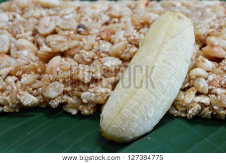 sweet made of rice nut sesame eat with golden banana for Thai merit day
