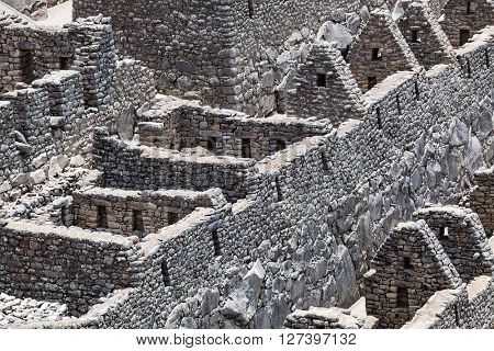 ruin walls and houses to Machu Picchu