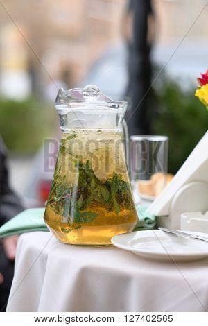 Lemonade pitcher at restaurant outdoor table