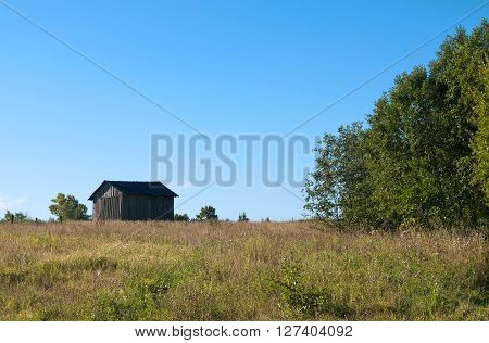 Barn in a field on the outskirts of the village