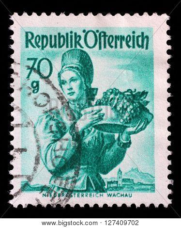 ZAGREB, CROATIA - SEPTEMBER 13: A stamp printed in Austria shows image woman in national Austrian costumes, Lower Austria, Wachau, series, circa 1949, on September 13, 2014, Zagreb, Croatia