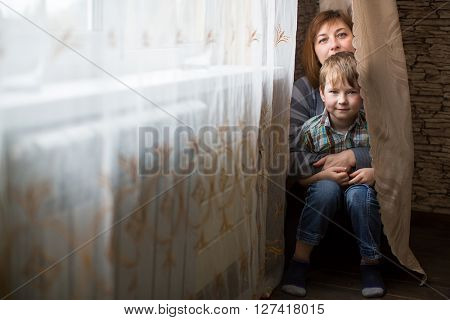 Mother with a young son in the room.