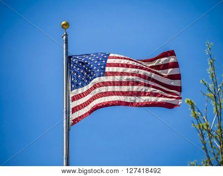 American flag on the blue sky