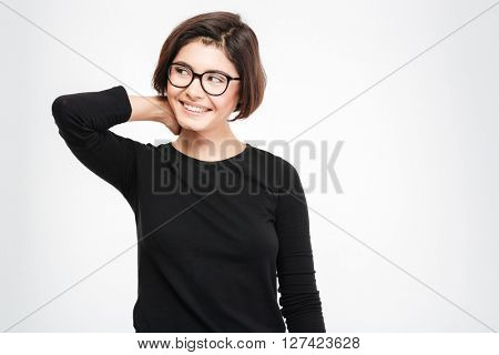 Smiling woman in glasses looking away isolated on a white background