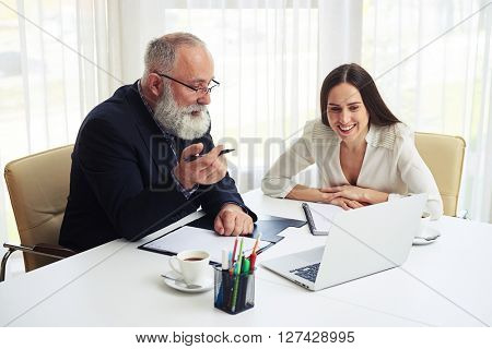 Young businesswoman consulting new business plans with her colleague