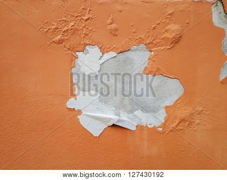 Deteriorated exterior paint of orange house wall poster