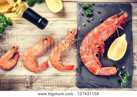 Fine selection of jumbo shrimps for dinner on stone plate. Food background