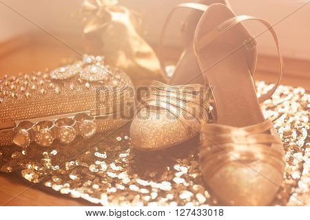 Womens Clothes And Accessories. Golden. Fashion Shoes. Expensive Luxury Jewelry Close-up Background.