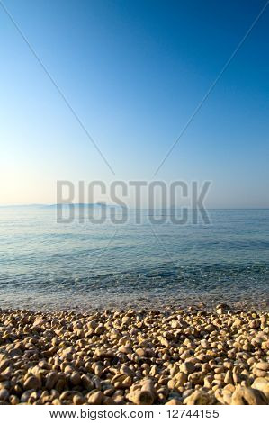 pebble and blue water of Adriatic sea