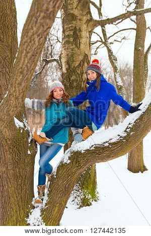 Two Winter Women Have Fun Outdoors