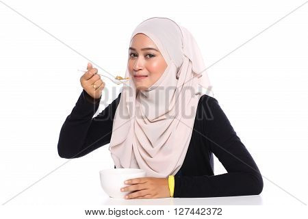 Young Asian Woman Eat Cereals For Breakfast