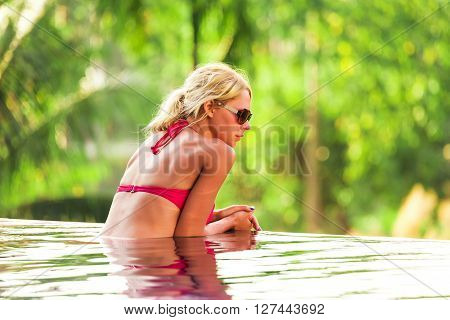 Young Pretty Blonde Woman In Swimming Pool
