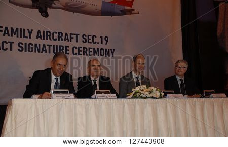 ANKARA/TURKEY- APRIL 29, 2015: Muharrem Dortkasli (President & CEO TAI (L) at the Turkish Aerospace Industry-TAI's hangar during the A320 Family Aircraft Sec.19 Contract Signature Ceremony. April 29, 2015-Ankara/Turkey