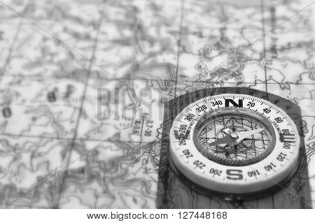 Tools for the journey - a map and a compass. Magnetic compass is located on a topographic map.