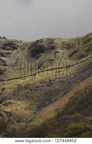 Lady of Snowdon. Face profile on a steep hillside in Snowdonia near Llanberis Gwynedd Wales UK.