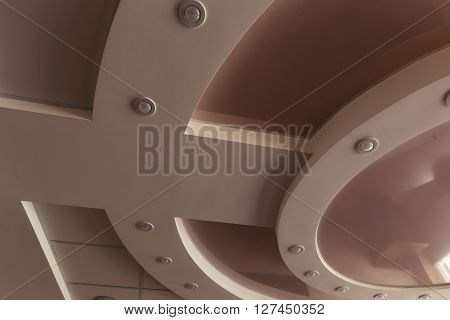 Modern layered ceiling with embedded lights and stretched ceiling inlay special toned photo