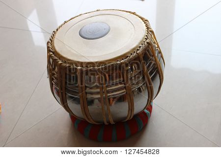 The larger of the two drums that comprise the traditional Indian tabla, also known as the 'bayan'.