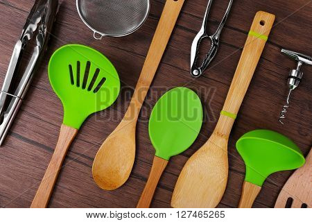 Set of stainless and wooden utensils on wooden background