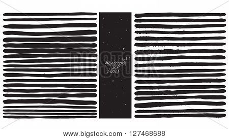Set of 40 thick lines made with hand and ink freehand ornated with splashes spots brush blobs. Vector black and white illustration good for creative designs drawn with imperfections.