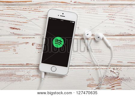 WROCLAW, POLAND - APRIL 12, 2016: Apple iPhone SE smartphone with Spotify app on screen