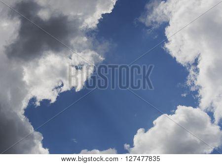 clouds sky rays of sun breaking cumulonimbus