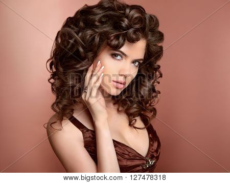 Hairstyle. Beautiful Young Woman With Long Curly Hair, Beauty Makeup And Polish Manicured Nails. Bru