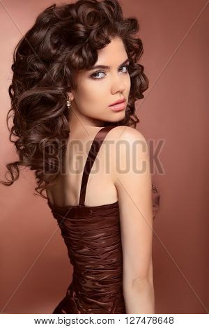 Healthy Hair. Beautiful Brunette Young  Woman With Long Curly Hairs. Elegant Lady With Professional