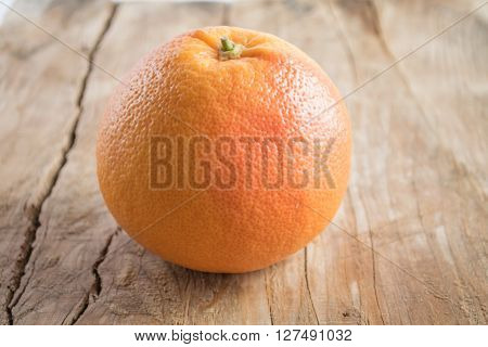 Grapefruit Isolated On Wooden Background