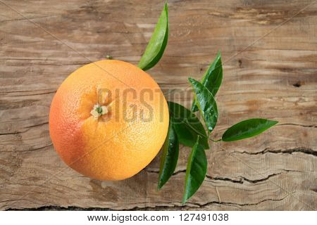 Grapefruit With Leaves Isolated On Wooden Background