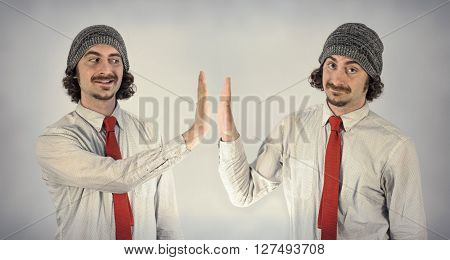 Twin adult men with beards high five eachother