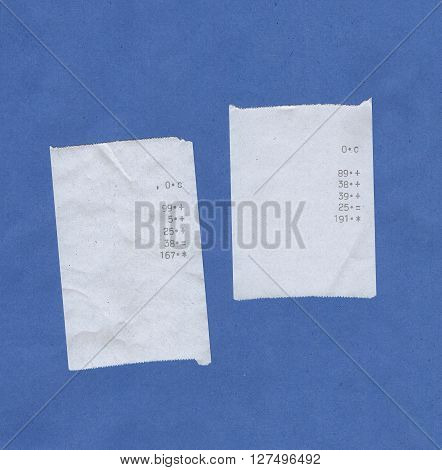 Bills or receipts isolated over blue background