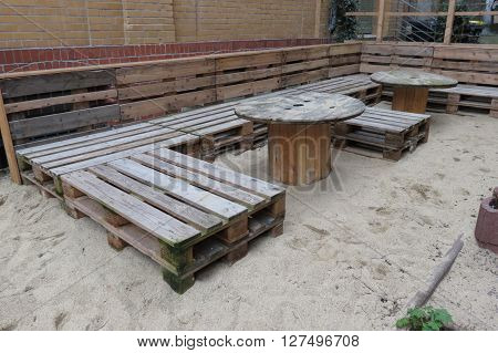 HALLE (SAALE) GERMANY - CIRCA MARCH 2016: Post industrial or hipster restaurant with high voltage cable coils as tables and pallets as seats