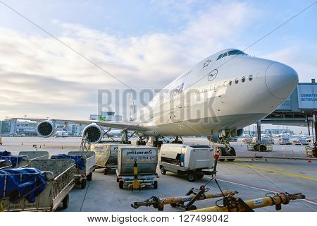 FRANKFURT, GERMANY - CIRCA MARCH 2016: Lufthansa Boeing 747-8 docked in Frankfurt Airport. Frankfurt Airport is a major international airport located in Frankfurt