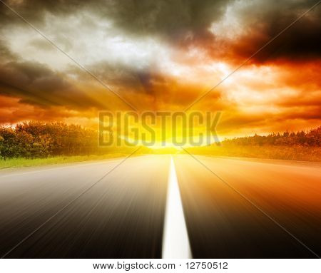 blur road and dramatic sky