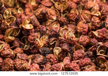 Szechuan Peppercorns Close Up covering background image