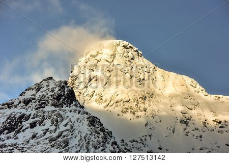 Mountain peaks from the town of Nusfjord in the Lofoten Islands Norway in the winter. poster