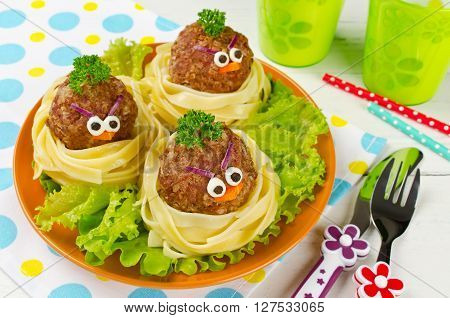 Funny spaghetti with meatballs for kids. Birds in nests