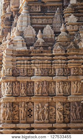The wall of the temple of Adinath the XII century of our era decorated with the bas-reliefs representing sketches about life of ancient India. Made of sandstone.