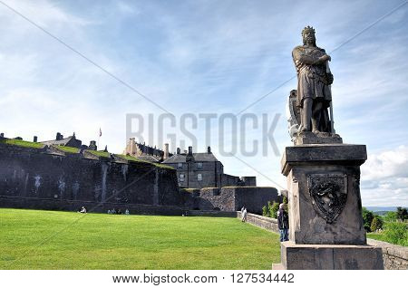 Robert the Bruce  stone statue in front of Stirling castle. Scotland
