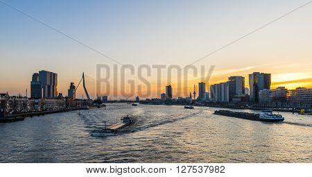 Rotterdam, The Netherlands - February 29, 2016: Rotterdam Evening light Nieuwe Maas and Erasmus Bridge.